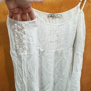 White flowy top with cut-out shoulders